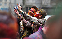 A couple takes a picture of them self during Holi Hai Celebration in New York , March 31, 2013. The festival has many purposes. First and foremost, it celebrates the beginning of the new season, spring.VIEWpress /Kena Betancur