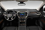 Stock photo of straight dashboard view of 2020 GMC Acadia Denali 5 Door SUV Dashboard