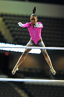 02/20/09 - Photo by John Cheng for USA Gymnastics.  US gymnast Hallie Mossett performs on uneven bars in a meet against Japan before the Tyson American Cup at Sears Centre Arena in Chicago.