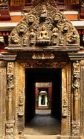 Art in architecture - a hand crafted door crest at the entrance of a temple in the heritage complex at Kathmandu, Nepal