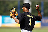 03 September 2011: Roeland JR. Henrique of L&D Amsterdam Pirates throws to third base during game 1 of the 2011 Holland Series won 5-4 in inning number 14 by L&D Amsterdam Pirates over Vaessen Pioniers, in Hoofddorp, Netherlands.