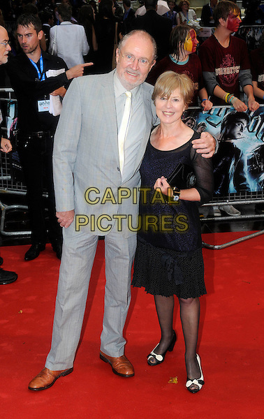 "JIM BROADBENT & WIFE ANASTASIA LEWIS .Arriving at the World Premiere of ""Harry Potter and the Half-Blood Prince"" at the Odeon cinema, Leicester Square, London, England, UK, July 7th 2009..Half Blood  full length grey gray suit white tie brown shoes .CAP/FIN.©Steve Finn/Capital Pictures"