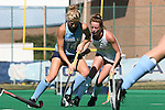 25 October 2014: North Carolina's Emma Bozek (14) and Wake Forest's Kali Vicars (25). The University of North Carolina Tar Heels hosted the Wake Forest University Demon Deacons at Francis E. Henry Stadium in Chapel Hill, North Carolina in a 2014 NCAA Division I Field Hockey match. UNC won the game 3-1.