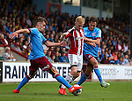 Mark Duffy of Sheffield Utd tackled by Harry Toffolo of Scunthorpe Utd and Josh Morris of Scunthorpe Utd during the English League One match at Glanford Park Stadium, Scunthorpe. Picture date: September 24th, 2016. Pic Simon Bellis/Sportimage
