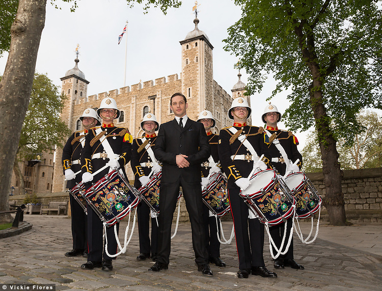 Royal Marines pose in front of the Tower of London on 30th April 2014 with British actor, Tom Hardy. The Royal Marines Corps of Drums are attempting to break the World record for the longest continuous drum roll as part of a year of celebrations to mark the 350th anniversary of the Royal Marines and raising money for the Royal Marines Charitable Trust Fund.  The current record stands at 28 hours, 19 minutes and 3 seconds and they hope to extend this to 64 hours.