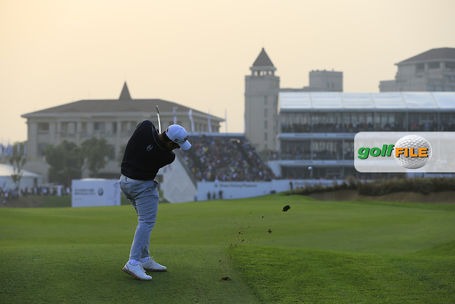 Alexander Levy (FRA) plays his 2nd shot on the 18th hole during Sunday's Final Round of the 2014 BMW Masters held at Lake Malaren, Shanghai, China. 2nd November 2014.<br /> Picture: Eoin Clarke www.golffile.ie
