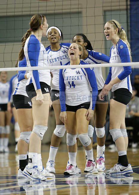 The team celebrates after a point during the UK women's volleyball game v. East Tennessee University during the NCAA tournament in Memorial Coliseum in Lexington, Ky., on Friday, November 30, 2012. Photo by Genevieve Adams | Staff