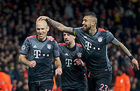 Arjen Robben of Bayern Munich (10) celebrates with Franck Ribery and Arturo Vidal (right) after scoring their 2nd goal to make it 1-2 on the night during the UEFA Champions League round of 16 match between Arsenal and Bayern Munich at the Emirates Stadium, London, England on 7 March 2017. Photo by Alan  Stanford / PRiME Media Images.