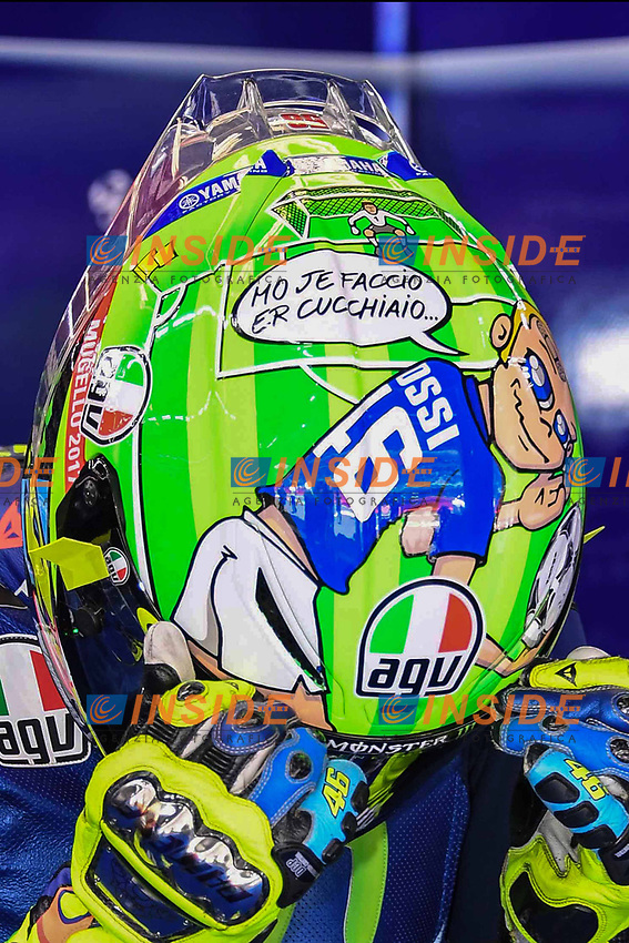 SCARPERIA,FLORENCE, ITALY - JUNE 03:,2017 Valentino Rossi of Italy and Movistar Yamaha MotoGP  presents his new helmet dedicated to AS Roma football star Francesco Totti  during  Qualifying MotoGP Gran Premio d'Italia- at Mugello Circuit. on june 03, 2017 in Scarperia Italy.<br /> (Photo by Marco Iorio)