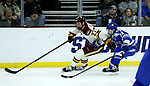 SIOUX FALLS, SD - MARCH 24: Riley Tufte #27 from Minnesota Duluth pushes the puck past Zack Mirageas #74 from Air Force during their game at the 2018 West Region Men's NCAA DI Hockey Tournament at the Denny Sanford Premier Center in Sioux Falls, SD. (Photo by Dave Eggen/Inertia)