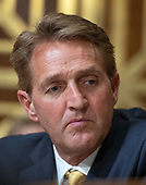 """United States Senator Jeff Flake (Republican of Arizona) listens as US Secretary of State Mike Pompeo testifies before the US Senate Committee on Foreign Relations on """"An update on American Diplomacy to Advance our National Security Strategy"""" on Capitol Hill in Washington, DC on Wednesday, July 25, 2018.  Pompeo took questions on the Helsinki Summit with President Putin of Russia and progress on the denuclearization of North Korea.<br /> Credit: Ron Sachs / CNP"""