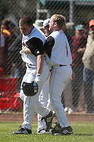 February 28, 2010:  Phil Wunderlich of the Louisville Cardinals congratulated by Drew Haynes (1) after hitting a walk off home run during the Big East/Big 10 Challenge at Raymond Naimoli Complex in St. Petersburg, FL.  Photo By Mike Janes/Four Seam Images