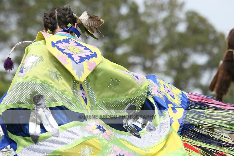 "A Native American dancer performs a ""Fancy Dance"" at the 8th Annual Red Wing PowWow in Virginia Beach, Virginia."