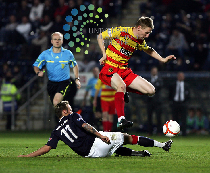 Falkirk v Partick Thistle.Falkirk Stadium.Tuesday 19th April 2011 .Irn Bru 1st Division - Score 2-0.Chris Erskine jumps the tackle from Kallum Higginbotham.www.universalnewsandsport.com.(0ffice) 0844 884 51 22....