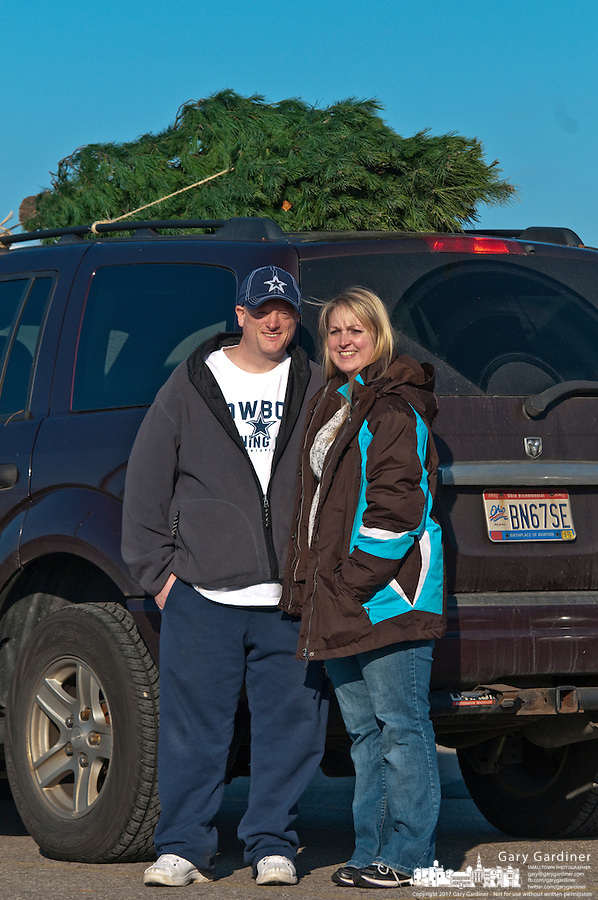 Dawn and Steve Green buy their first Christmas tree as a married couple. Married 11/11/11, the eager pair shopped at the Oakland Nursery sales lot the day before Thanksgiving, two days before the lot officially opened for business.