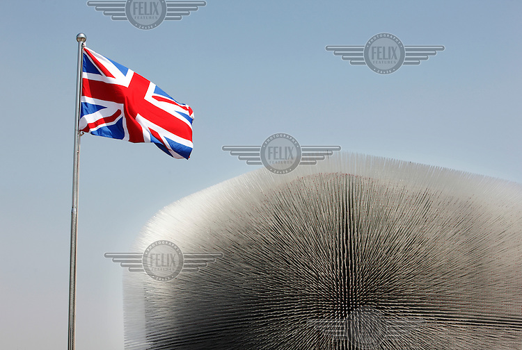 The British Union Jack flies in front of the UK Pavilion, nicknamed The Dandelion, at the 2010 World Expo site.