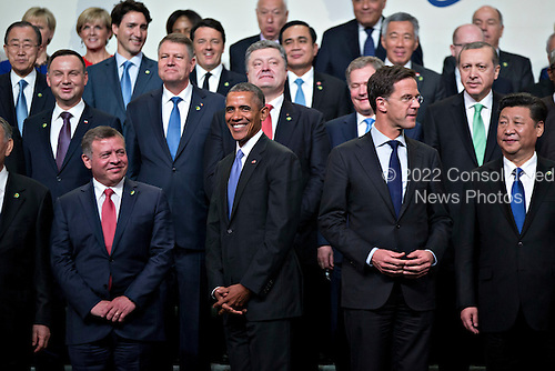 Xi Jinping, China's president, from right, Mark Rutte, Dutch prime minister, United States President Barack Obama and King Abdullah II ibn Al Hussein of Jordan stand during a family photo at the Nuclear Security Summit in Washington, D.C., U.S., on Friday, April 1, 2016. After a spate of terrorist attacks from Europe to Africa, Obama is rallying international support during the summit for an effort to keep Islamic State and similar groups from obtaining nuclear material and other weapons of mass destruction. <br /> Credit: Andrew Harrer / Pool via CNP