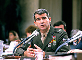 United States Marine Corps Lieutenant Colonel Oliver North testifies before the joint US House Select Committee to Investigate Covert Arms Transactions with Iran and the US Senate Select Committee on Secret Military Assistance to Iran and the Nicaraguan Opposition on Capitol Hill in Washington, DC on July 14, 1987.  On May 7, 2018 North was named as the president of the National Rifle Association (NRA).<br /> Credit: Ron Sachs / CNP