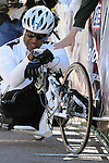 May 20, 2011 Colorado Springs, CO.   SOCOM cyclist, Alfredo Delossantos, breaks his chain 2km from the finish of the handcycle event and pushes himself to the finish during the 2011 Warrior Games  at the U.S. Air Force Academy, Colorado Springs, CO...
