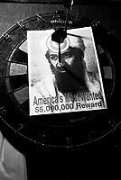 A wanted picture of Osama Bin Laden hangs on a dartboard in a firehouse in lower Manhattan.   Septemer 15, 2001.(