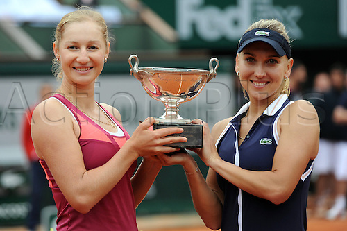 09.06.2013 Paris, France. Elena Vesnina of Russia and Ekaterina Makarova of Russia hold the Winners Trophy after the match against Sara Errani of Italy and Roberta Vinci of Italy in the Women's Doubles Final of the French Open from Roland Garros.