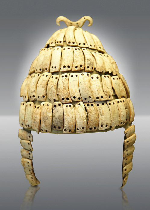 Boar's tusk helmet with cheek guards and double bone hook on top. Tomb 515 Mycenae, Greece. 14th-15th century BC. National Archaeological Museum, Athens.. The Boar's tusk helmet was described in the Iliad as follows &quot;Meriones gave Odysseus a bow, a quiver and a sword, and put a cleverly made leather helmet on his head. On the inside there was a strong lining on interwoven straps, onto which a felt cap had been sewn in. The outside was cleverly adorned all around with rows of white tusks from a shiny-toothed boar, the tusks running in alternate directions in each row.<br /> &mdash;Homer, Iliad 10.260&ndash;5&quot;