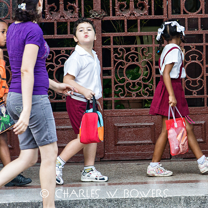 Faces Of Cuba - Mom escorting the kids to school.<br />