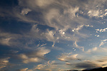 wide photograph of landscape by Paolo Diego Salcido of clouds in blue sky.