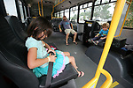 Mark Kuniya and his kids Miya, 7, and Toshi, 4, check out a JAC bus during the Touch-a-Truck event at the Carson City Library in Carson City, Nev., on Saturday, Aug. 5, 2017. <br /> Photo by Cathleen Allison/Nevada Photo Source
