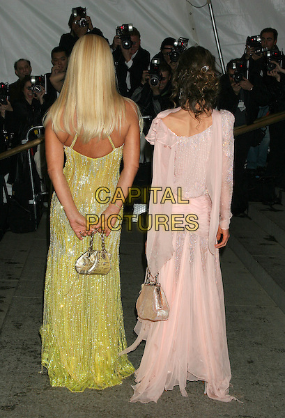 "DONATELLA VERSACE & ALLEGRA VERSACE.""Chanel"" Costume Institute Gala at The Metropolitan Museum of Art - Arrivals.The Metropolitan Museum of Art, New York City.New York City.May 2nd, 2005.full length mother daughter family arms behind back purse bag back behind rear skinny bony back.www.capitalpictures.com.sales@capitalpictures.com.©Capital Pictures"