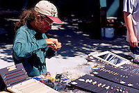Artisan making and selling Hand-Crafted Jewelry at the Public Market at Bastion Square, Victoria, Vancouver Island, BC, British Columbia, Canada