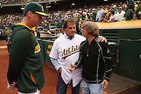 OAKLAND, CA - AUGUST 9:   Hall of Fame Manager Tony La Russa talks with manager Bob Melvin #6 and director of team travel Mickey Morabito of the Oakland Athletics before the game against the Minnesota Twins at O.co Coliseum on Saturday, August 9, 2014 in Oakland, California. Photo by Brad Mangin