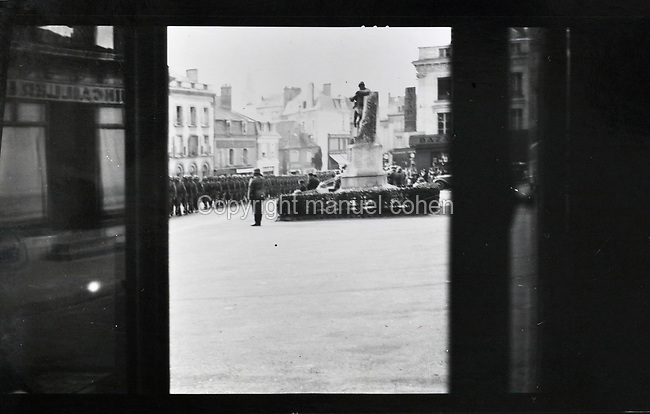 German military parade on the Place du Marechal Petain, (now the Place de la Mairie), during the German occupation of France in Second World War, photograph, in Sable-sur-Sarthe, Pays de la Loire, France. Collection G Cherrier. Picture by Manuel Cohen / Further clearances required
