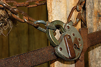 Rustic pad lock from pioneer times on a gate at Black Creek Pioneer Village in Toronto, Canada