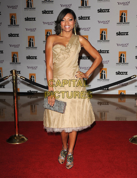 TARAJI P. HENSON.The Hollywood Film Festival's Gala Ceremony held at Beverly Hilton Hotel in Beverly Hills, California,  USA..October 27th, 2008     .full length beige gold one shoulder dress grey gray clutch bag hand on hip gold gladiator sandals shoes .CAP/DVS.©Debbie VanStory/Capital Pictures.