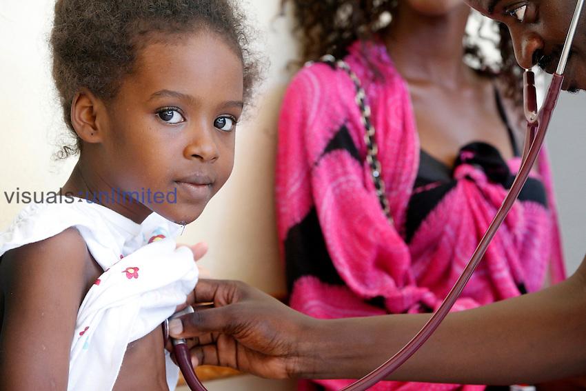Doctor examining child, Fann Hospital, Dakar, Senegal.