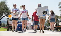 From left, Nancy Valdez '15, Teresa Mojarro '15 and Audrey Hahn '16 help incoming first-years move into Braun Hall during Occidental College Orientation, Aug. 22, 2014. (Photo by Marc Campos, Occidental College Photographer)