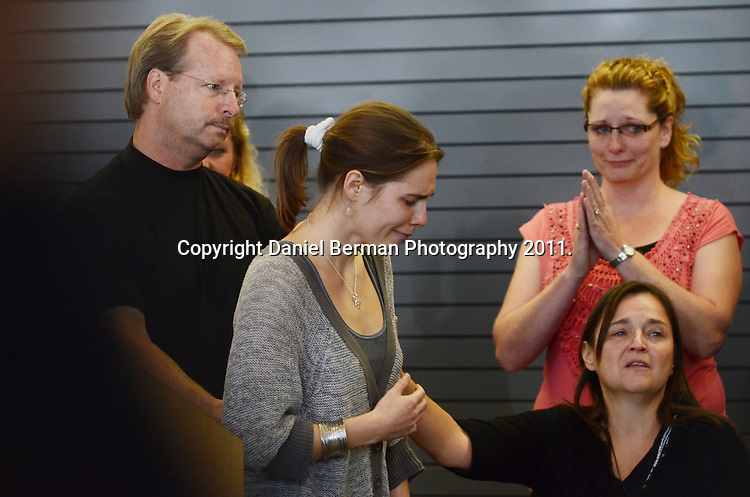 Amanda Knox is overcome with emotion following her brief address to the media upon her arrival in the United States at Seattle-Tacoma International Airport in Seattle Tuesday, October 4. Knox's murder conviction was overturned by an Italian appellate court after spending four years in prison in Italy. Photo by Daniel Berman/www.bermanphotos.com