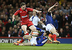 French pair Brice Dulin and Jean-Marc Doussain both fail to claim the loose ball allowing Wales center George North to pounce and score the first try of the match.<br /> RBS 6 Nations 2014<br /> Wales v France<br /> Millennium Stadium<br /> 21.02.14<br /> <br /> ©Steve Pope-SPORTINGWALES