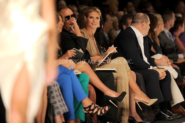 WWW.ACEPIXS.COM . . . . . .September 7, 2012...New York City.....Model Heidi Klum and designer Michael Kors watch the runway at the Project Runway Spring 2013 fashion show during Mercedes-Benz Fashion Week on September 7, 2012 ...Please byline: KRISTIN CALLAHAN - ACEPIXS.COM.. . . . . . ..Ace Pictures, Inc: ..tel: (212) 243 8787 or (646) 769 0430..e-mail: info@acepixs.com..web: http://www.acepixs.com .