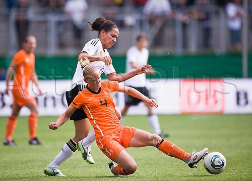 07 06 2011 Womens International Football. Germany versus Holland.  in Aachen. Celia Okoyino der Mbabi ger in Duel against Mandy van der Berg NED