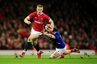 Johnny McNicholl of Wales is tackled by Camille Chat of France during the Guinness Six Nations Championship Round 3 match between Wales and France at the Principality Stadium in Cardiff, Wales, UK. Saturday 22 February 2020