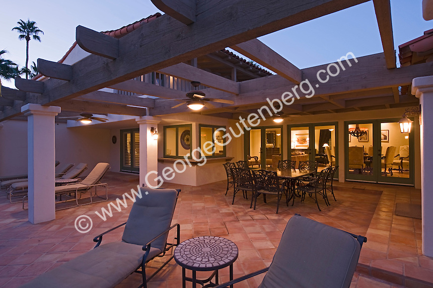 Dining set under patio cover of Spanish home