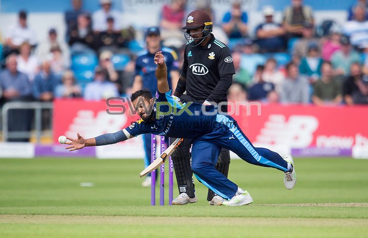 Picture by Allan McKenzie/SWpix.com - 13/06/2017 - Cricket - Royal London One-Day Cup - Yorkshire County Cricket Club v Surrey County Cricket Club - Headingley Cricket Ground, Leeds, England - Yorkshire's Azeem rafiq makes an attempted stop against Surrey.