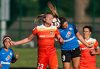 Kansas City, MO - Sunday July 02, 2017: Cami Privett and Lo'eau Labonta attempt a header during a regular season National Women's Soccer League (NWSL) match between FC Kansas City and the Houston Dash at Children's Mercy Victory Field.