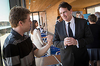 PQ Leadership candidate Pierre-Karl Peladeau chats with a young supporter during the presentation of parti Quebecois candidates for the upcoming byelection Tuesday May 5, 2015.