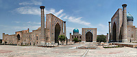 "Panoramic view of Registan Square, showing the Sher-Dor, 1619-36, (right), Tillya-Kori, 1646-60, (centre) and Ulugh Beg, 1417-20, (left) Madrasahs, Samarkand, Uzbekistan, pictured on July 15, 2010, in the morning. The Tillyah-Kori (gilded) Madrasah is part of the Registan Ensemble, surrounding a magnificent square. Commissioned by Yalangtush Bakhadur it is not only a school but also the grand mosque. The Sher-Dor Madrasah, commissioned by Yalangtush Bakhodur as part of the Registan ensemble, and designed by Abdujabor, takes its name, ""Having Tigers"", from the double mosaic (restored in the 20th century) on the tympans of the portal arch showing suns and tigers attacking deer. The lancet arched portal of the Ulugh Beg Madradsah, commissioned by the scholarly Ulugh Beg, faces the square and high well-proportioned minarets flank the corners. It was restored in the early twentieth century. Samarkand, a city on the Silk Road, founded as Afrosiab in the 7th century BC, is a meeting point for the world's cultures. Its most important development was in the Timurid period, 14th to 15th centuries. Picture by Manuel Cohen."