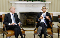 United States President Barack Obama speaks as US Vice President Joe Biden looks on while discussing the release of the Cancer Moonshot Report in the Oval Office of the White House on October 17, 2016 in Washington, DC.<br /> Credit: Olivier Douliery / Pool via CNP /MediaPunch