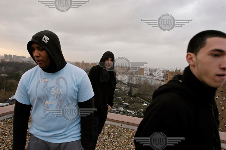 Youths who live in a banlieue housing project hang out on a rooftop in Pantin.