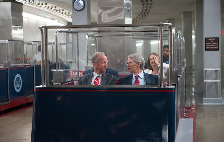UNITED STATES - August 2: Jerry Moran, R-KS., and Rob Portman, R-OH., talk as they enter the U.S. Capitol from the Senate subway on August 2, 2011. (Photo By Douglas Graham/Roll Call)